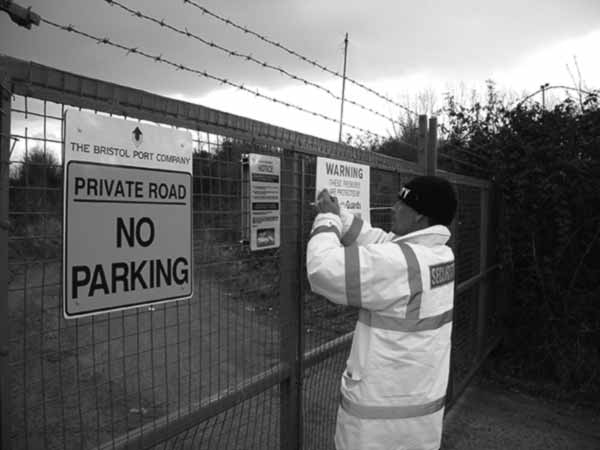 Guard adding signage to a compound we are patrolling.